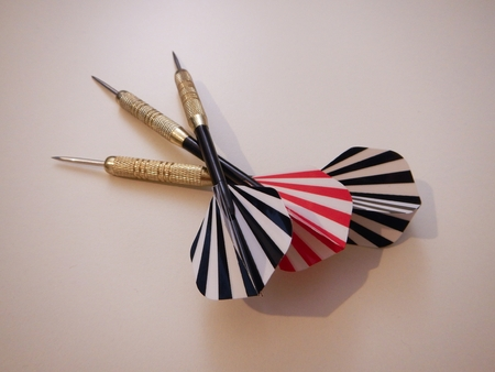 red and black darts on a simple white background