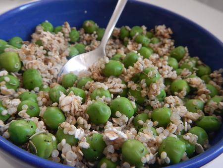 a detail of a vegetable salad with green peas