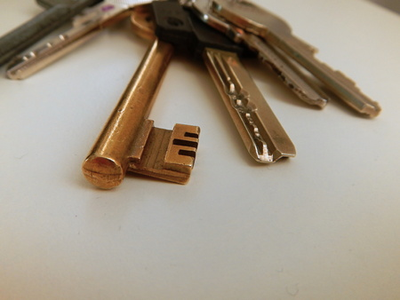 tresspass: some keys from home on a white table Stock Photo