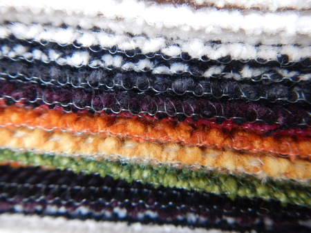variety of colorful fabrics samples at a tailors workshop