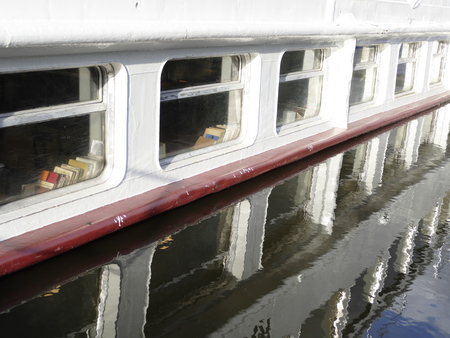 danubian: small boat windows reflected in a water level