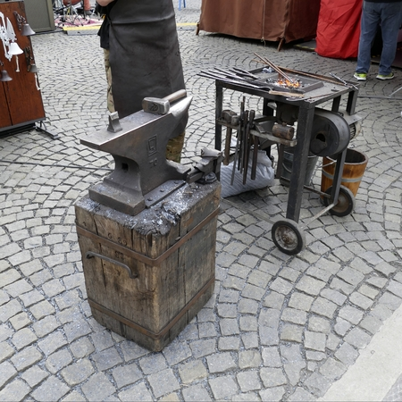 forge: street iron art craft with hammer and fire