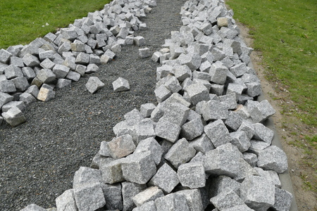 reconstruction of a pack sidewalk with cobble stone cubes