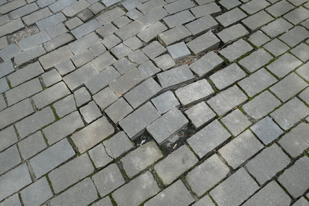 untidy: a broken pattern of street cobble pavement