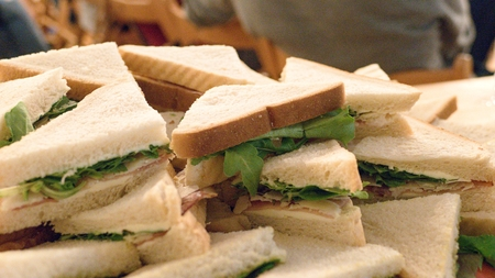 a pile of sandwiches with tomato and mozzarella with pesto
