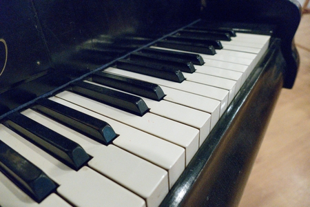 a close detail of black and white piano keys