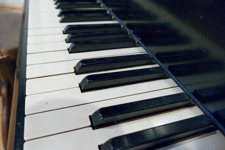 musical score: a close detail of black and white piano keys