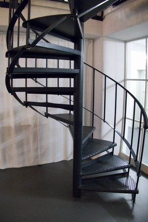 A Round Metal Indoor Staircase In A Corner Stock Photo   88250893