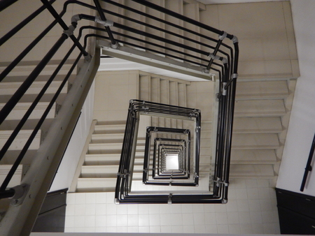 a square staircase in a very tall building Stock Photo