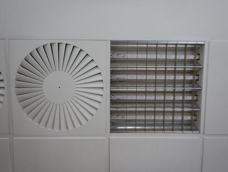 detail of ceilionv ventilation and light in an office building