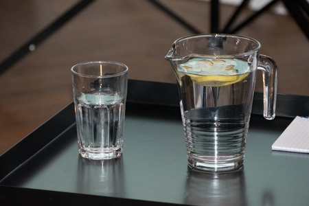 cool refreshing water with lemon on a table
