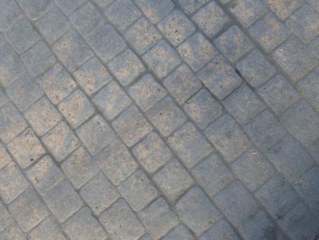 detail of texture of a concrete tiles pavement Stockfoto
