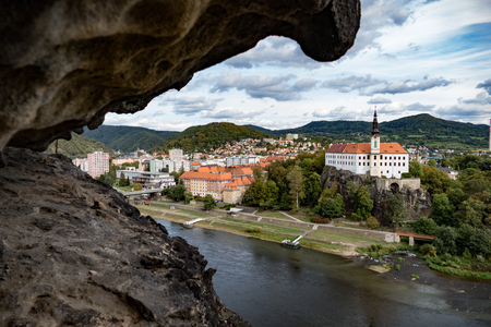 beautiful view of decin city in chzech republic from pastyrska stena rock above the valley 写真素材