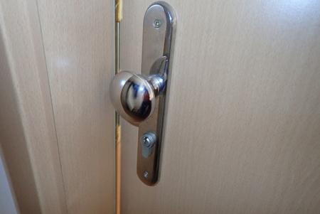 detail of metail door handle on a modern door Stock Photo