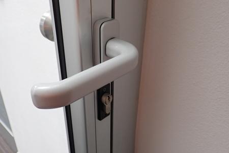 detail of metail door handle on a modern door Stock fotó