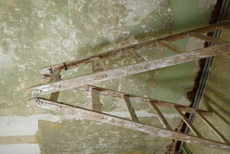an old wooden ladder on a building site Stock Photo