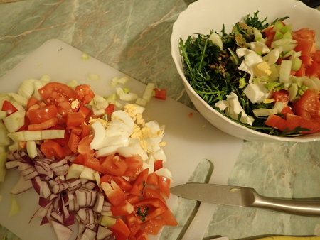 preparation of a fresh and healthy homemade vegetable saladin kitchen Stok Fotoğraf