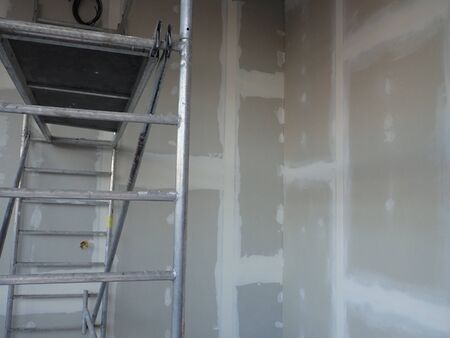 interior reconstruction  building site with plasterboards and a ladder