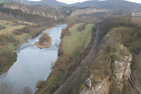 romantic beautiful lookout from tetin rock over berounka river in central bohemia with a train rail along the river