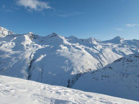 sunny cold beautiful skitouring day in otztal alps in austria alps