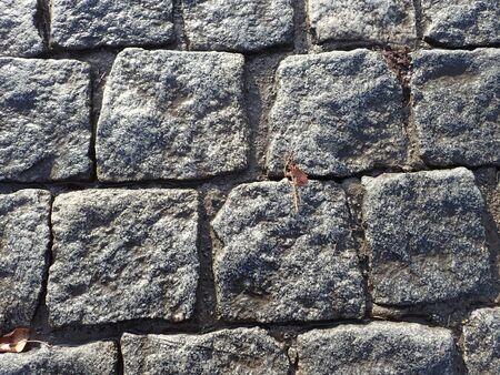 grey  cobble pavement texture wet after rain Stock Photo