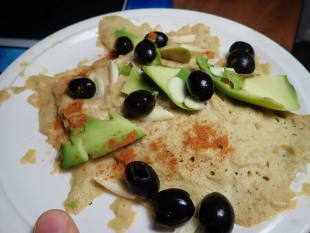 portion of unusualsalty porridge with olives and avocado
