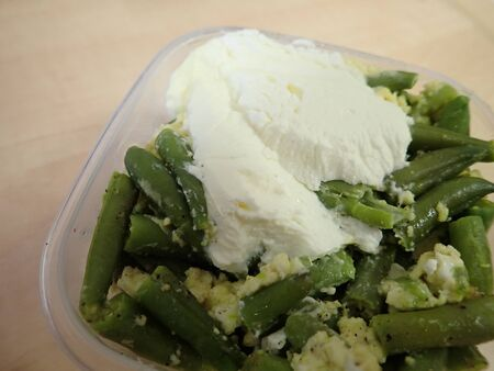 fresh tastyvegetable and legumes salad with cream