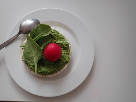 light healthy  diet round rice bread with green basil pesto