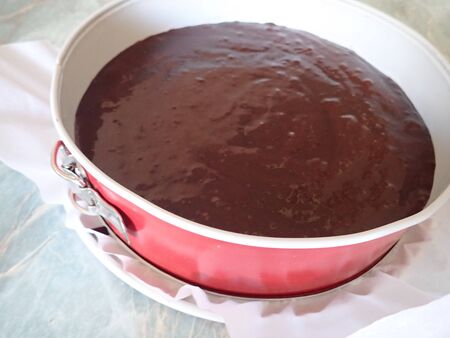 process of homemade preparation of sweet chocolate cake in the kitchen