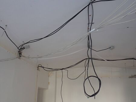mess  unorganised wires on a building site indoor
