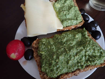 bread with pesto and cheese snack on a plate