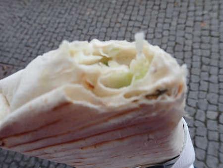 a fresh street food kebap tortilla portion wrapped