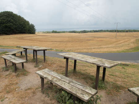 wooden behcnes and tables in a naturel picnic place in the countryside
