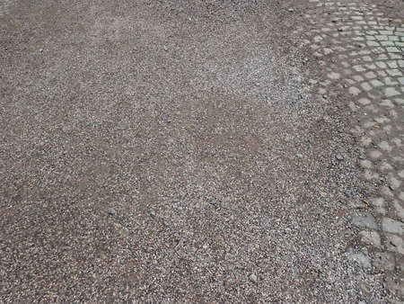 detail of pedestrian sidewalk with cobbles being repaired