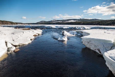 beautiful powerfull storforsen waterfall in winter in sweden Foto de archivo