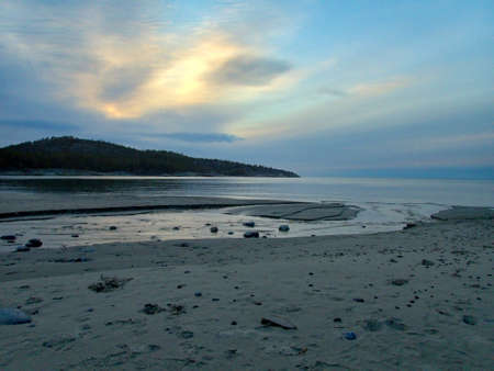 a beautiful quiet swedish lake coast in the winter