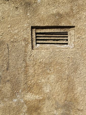 smal: Smal shuttered window in cement wall
