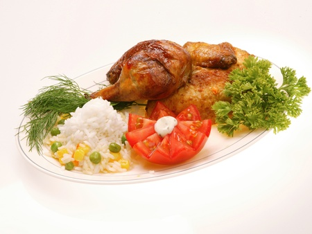 Grilled chicken with rice and vegetables photo