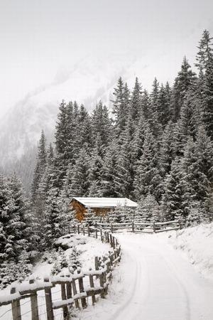 Mountain retreat in snowy weather, in the italian Alps.