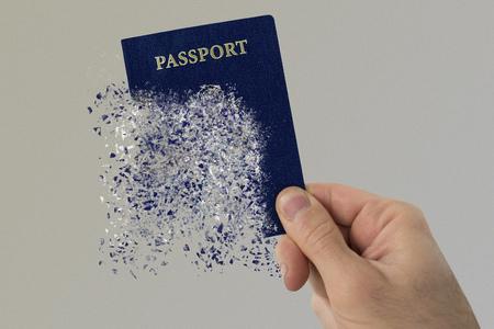 USA passport pulverizes in a mans hand.
