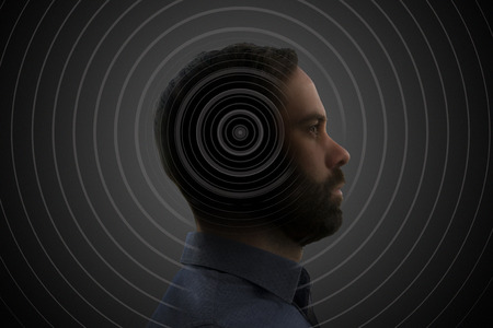 Concentric waves coming out of a mans head profile.
