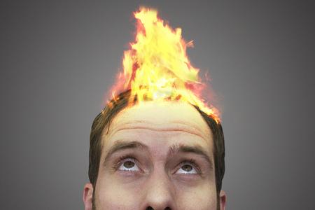 Fire on a mans head.