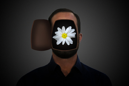 Daisy flower inside an opened mans head.