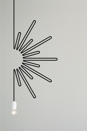 A lampss electrical cable draws the sun. Imagens