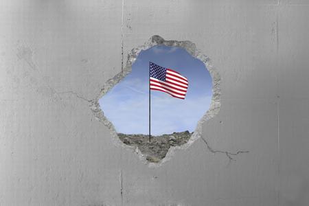 Usa flag behind a concrete wall. Imagens