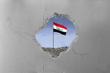 Iraq flag behind a concrete wall.