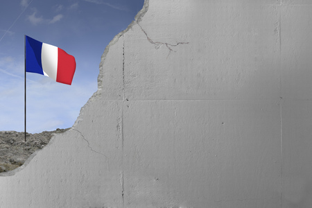 French flag behind a concrete wall. Imagens