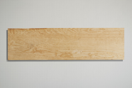 Rectangular plywood sign with grey background.