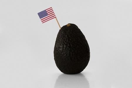 Isolated avocado with USA flag.