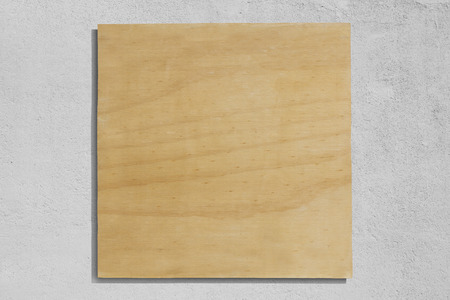 Square plywood sign with rough wall background. Imagens